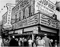 0172325 © Granger - Historical Picture ArchiveNATHAN'S FAMOUS, 1939.   Nathan's hot dog stand in Coney Island, Brooklyn, New York. Photograph, 1939.
