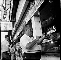 0172363 © Granger - Historical Picture ArchiveNATHAN'S HOT DOG STAND.   Nathan's Famous hot dog stand in Coney Island, Brooklyn, New York. Photograph, 1939.