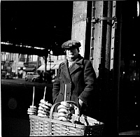 0172402 © Granger - Historical Picture ArchiveSELLING PRETZELS, 1935.   Pretzel vendor at First Avenue and 14th Street, New York City. Photograph, 1935.