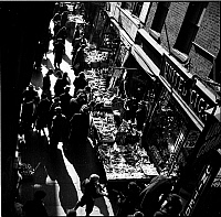 0172403 © Granger - Historical Picture ArchiveOUTDOOR MARKET, 1935.   Bird's eye view of the crowd at an outdoor market on First Avenue and 14th Street, New York City. Photograph, 1935.