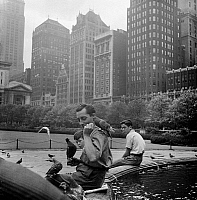 0172427 © Granger - Historical Picture ArchiveBRYANT PARK, 1940.   Feeding birds in Bryant Park, New York City. Photographed by Andrew Herman for the Federal Arts Project, a New Deal program, in 1940.
