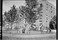 0172448 © Granger - Historical Picture ArchiveCHILDREN IN A PLAYGROUND.   Children in the playground of a Harlem housing project, New York City. Photograph, 1939.