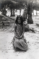 0245740 © Granger - Historical Picture ArchiveHEREHERETUE ATOLL, TUAMOTU ARCHIPELAGO, POLYNESIA.   A young girl poses on the beach. No Credit Given.