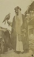 0245799 © Granger - Historical Picture ArchiveBAGHDAD, IRAQ.   An Arab sheik gazes at his pet falcon. David G. Fairchild.