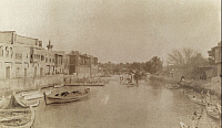 0245802 © Granger - Historical Picture ArchiveBURSA, IRAQ.   Several buildings loom above a canal filled with boats. David G. Fairchild.