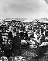 0245832 © Granger - Historical Picture ArchiveNOVGOROD, RUSSIA.   Vendors and shoppers at the Russian cloth market in Nijni-Novgorod. Underwood And Underwood.