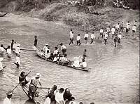 0245988 © Granger - Historical Picture ArchiveAYUTTHAYA, SAIM.   Thai people ford a canal by foot and on boat. Eliza R. Scidmore.