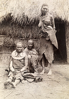 0246122 © Granger - Historical Picture ArchiveGERMAN EAST AFRICA.   Village women in front of a thatched hut. David Fairchild.