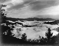 0246250 © Granger - Historical Picture ArchiveMOUNT WILSON, SAN GABRIEL MOUNTAINS, CALIFORNIA, USA.   A sea of fog and clouds looking toward the San Antonio peak. Ferdinand Ellerman.