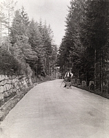 0246332 © Granger - Historical Picture ArchiveTHE BLACK FOREST, BADEN WURTTEMBERG, GERMANY.   A laborer repairs road problems on a rock lined Black Forest road. Karl Frederick Geiser.