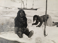 0246840 © Granger - Historical Picture ArchiveNORTH STAR BAY, GREENLAND.   Eskimo men float on an ice flow; a tall ship is in the background. Underwood And Underwood.