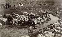 0246917 © Granger - Historical Picture ArchiveEDOM, SOUTHERN JORDAN.   Bedouin women fill animal skins with water from a winding stream. Franklin Hoskins.