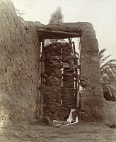 0246930 © Granger - Historical Picture ArchiveEL JOWF, ARABIA.   Palm tree trunks are used to construct doors in north Nejd. Archibald Forder.