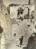 0246958 © Granger - Historical Picture ArchiveSICILY, ITALY.   A musician serenades a woman leaning over a stone balcony in ruins. Baron Wilhelm Von Gloeden.