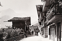 0247093 © Granger - Historical Picture ArchiveCHAMPERY, VALAIS, SWITZERLAND.   Villagers convene on a chalet-lined street. Jullien Freres.