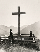 0247094 © Granger - Historical Picture ArchiveVALAIS, SWITZERLAND.   Women stand around a fenced-in cross built on an alpine hilltop. Jullien Freres.