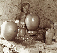 0247494 © Granger - Historical Picture ArchiveDAMASCUS, SYRIA.   An elderly man at work at a potters wheel surrounded by pots. Archibald Forder.