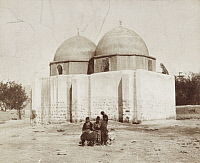 0247508 © Granger - Historical Picture ArchiveDAMASCUS, SYRIA.   Men sit in front of a domed and sacred Islamic shine. Archibald Forder.