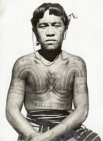 0248173 © Granger - Historical Picture ArchiveLUZON ISLAND, PHILIPPINES.   A Bontoc Igorot man with multiple tattoos on his arms and chest. Charles Martin.