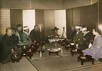 0248288 © Granger - Historical Picture ArchiveJAPAN.   Families of a bride and groom kneel for a Japanese wedding feast. Eliza R. Scidmore.