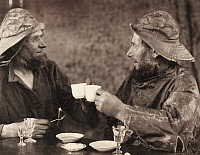 0248306 © Granger - Historical Picture ArchiveBRITTANY, FRANCE.   Two fishermen sit and clink their teacups together in a toast. E. M. Newman.
