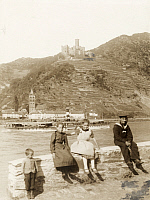 0248502 © Granger - Historical Picture ArchiveGERMANY.   Children sit on a rock with the Rhine and Castle Tahneck behind them. Underwood And Underwood.