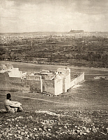 0248681 © Granger - Historical Picture ArchiveALEPPO, TURKEY.   A man sits on a hill overlooking the fortress and gardens of Aleppo. Underwood And Underwood.