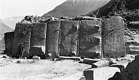 0249131 © Granger - Historical Picture ArchiveOLLANTAYTAMBO, PERU.   Naturalist, Foote, stands before the six monoliths of the fortress. Hiram Bingham.