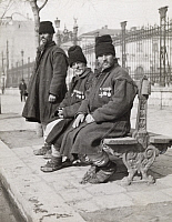 0249155 © Granger - Historical Picture ArchiveRUMANIA.   Peasant veteran soldiers from the Russo-Turkish wars on a city bench. Frederick Moore.