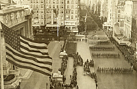 0249393 © Granger - Historical Picture ArchiveFIFTH AVENUE, NEW YORK CITY, NEW YORK, UNITED STATES.   Hundreds of WWI soldiers march on Fifth Avenue as U.S. flags fly. Paul Thompson.