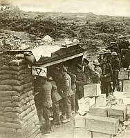 0249398 © Granger - Historical Picture ArchiveEUROPE.   WWI allied forces on the front, line up at a YMCA bunker for supplies. Young Men'S Christian Assoc.