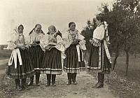0249465 © Granger - Historical Picture ArchiveHUNGARY.   Hungarian girls dressed in formal attire walk down a dirt path. A. W. Cutler.