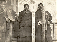 0250095 © Granger - Historical Picture ArchiveLHASA, TIBET, CHINA.   Tibetan lamas hold fasces awarded from the Chinese emperor. Shaoching H. Chuan.