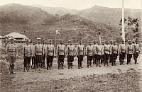 0250246 © Granger - Historical Picture ArchiveLUZON, PHILIPPINES.   Ifugao constabulary soldiers stand in front of rice terraces in Luzon. Dean C. Worcester.