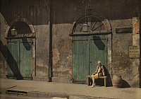 0250607 © Granger - Historical Picture ArchiveNEW ORLEANS, LOUISIANA, USA.   A woman sits outside the doorway of New Orlean's Absinthe House. Edwin L. Wisherd.