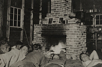 0251047 © Granger - Historical Picture ArchiveHANOVER, NEW HAMPSHIRE, USA.   Members of the Dartmouth Outing Club sleep on the floor by the fire. Fred H. Harris.