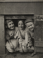 0251099 © Granger - Historical Picture ArchiveCHILDREN.   Three children smile out of a small confined space. Harry F. Blanchard.