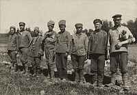 0251265 © Granger - Historical Picture ArchiveLATVIA.   Bolshevik soldiers stand at attention in a field. A. Frankl.