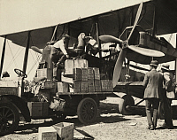 0251323 © Granger - Historical Picture ArchiveENGLAND.   Men fill up the petroleum tanks of an airplane. Sir Ross Smith.