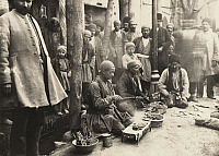 0251391 © Granger - Historical Picture ArchivePERSIA.   People watch men cook mutton at an outdoor restaurant on the street. Faye Fisher.