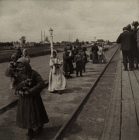 0251487 © Granger - Historical Picture ArchiveWESTERN SIBERIA, RUSSIA.   Children sell flowers to passengers on the Trans-Siberian Railway. Ella R. Christie.