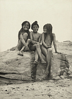 0251674 © Granger - Historical Picture ArchiveARIZONA, USA.   Three naked, Hopi girls sit together on a rock ledge. Frederick I. Monsen.