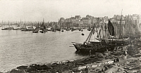 0251705 © Granger - Historical Picture ArchiveDOUARNENEZ, BRITTANY, FRANCE.   People on the shores of a harbor crowded with sardine fishing boats. Crete, Ltd..