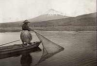 0251729 © Granger - Historical Picture ArchiveFUJI, JAPAN.   A fisherman pulls a net towards his boat in a lake near Mount Fuji. Kiyoshi Sakamoto.