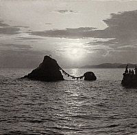 0251730 © Granger - Historical Picture ArchiveFUTAMI, JAPAN.   The Meoto Iwa, or Man and Wife Rocks are connected with sacred rope. Kiyoshi Sakamoto.