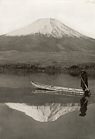 0251757 © Granger - Historical Picture ArchiveLAKE SHOJI, JAPAN.   A boat passes across a reflection of Mount Fuji on Lake Shoji. Willard Price.