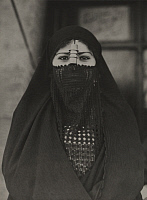 0251763 © Granger - Historical Picture ArchiveCAIRO, EGYPT.   An Egyptian woman, with an elaborately sewn veil, shows only her eyes. Maynard Owen Williams.