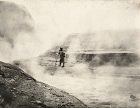 0251877 © Granger - Historical Picture ArchiveKATMAI NATIONAL PARK AND PRESERVE, ALASKA, USA.   A man stands in the steam rising from the hot springs. E. G. Zies.
