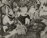 0251989 © Granger - Historical Picture ArchiveLOJA, ECUADOR.   Children watch vendors sell breads baked in special shapes. H. E. Anthony.
