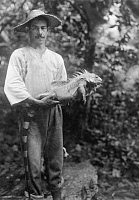0252338 © Granger - Historical Picture ArchiveTABOGA, PANAMA.   A man holds one of Taboga's native Iguanas. David G. Fairchild.